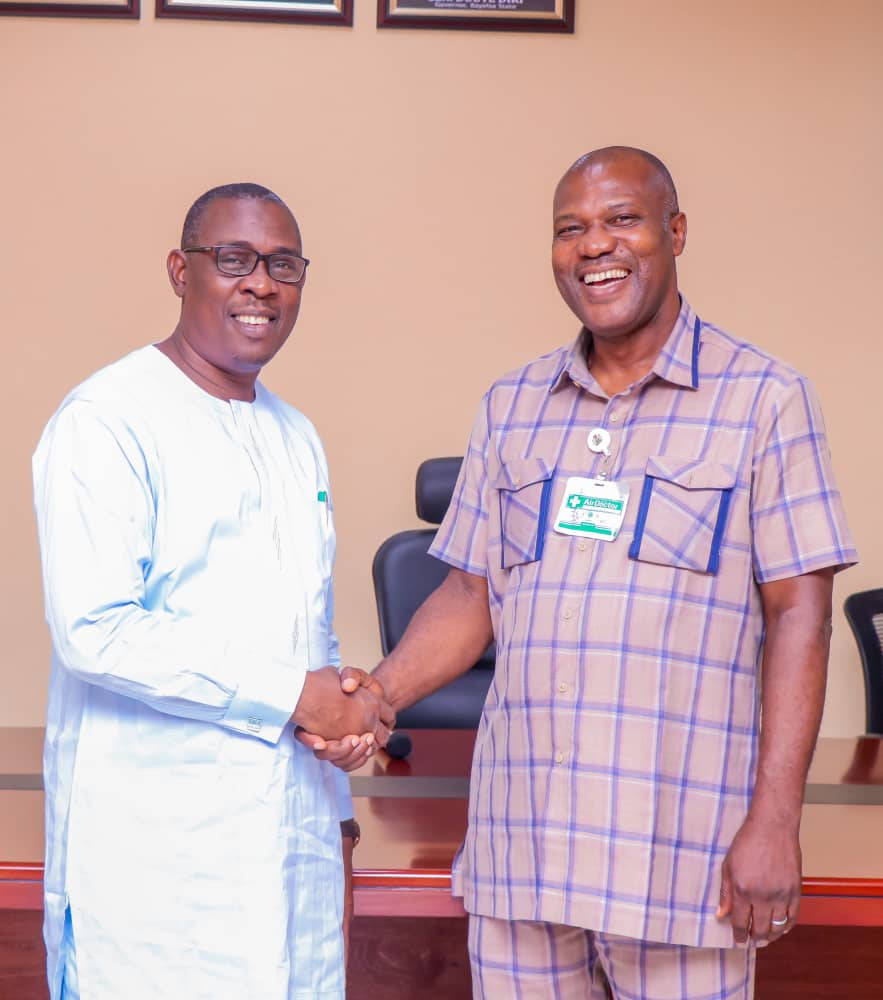 Secretary to the State Government, Rt. Hon Friday Konbowei Benson (left) and chairman of the Committee.