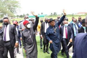 Gov. Okowa (left) and Gov. Emmanuel acknowledging cheers after the inauguration