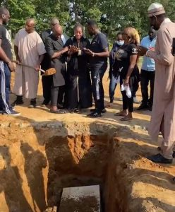 The late Sound Sultan's widow being consoled