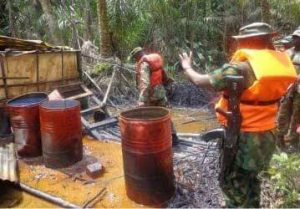 File photo of Men of the Nigerian Army destroying an illegal refinery in the N/Delta