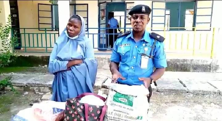 An Alleged Bandit's Wife Detained In Katsina With 3 Gallons Of Fuel Hidden Under Her Hijab.